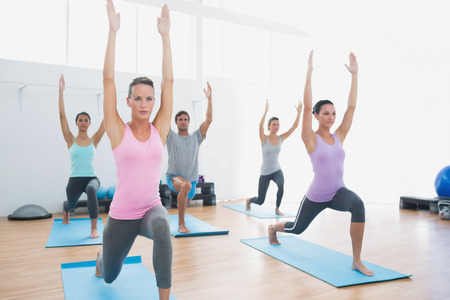 27119265 - sporty class doing pilate exercises in the fitness studio